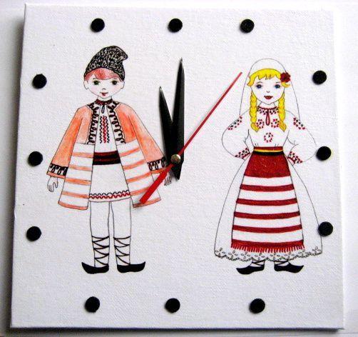 Ceas de perete cu barbat si femeie imbracati in costume traditionale 28343