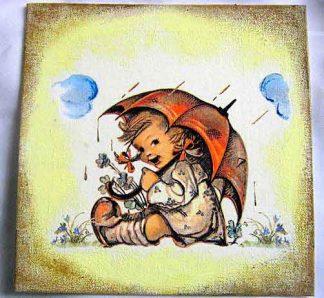Fetita stand in sezut, zambind sub o umbrela pe o vreme ploioasa 28853