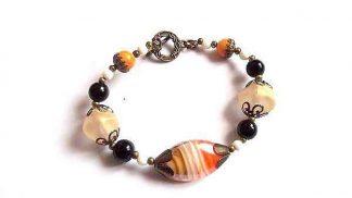 Bratara margele de sticla negre, portocalii si albe, bratara femei 32169